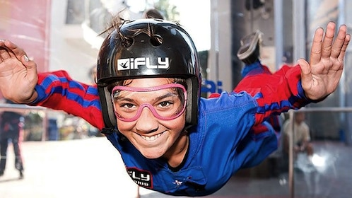 Girl skydiving in iFly