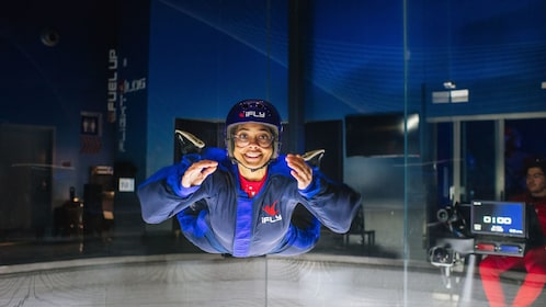 Woman smiling while flying at iFly