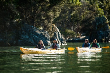 Kayakers on still waters of Lake Wanaka in New Zealand