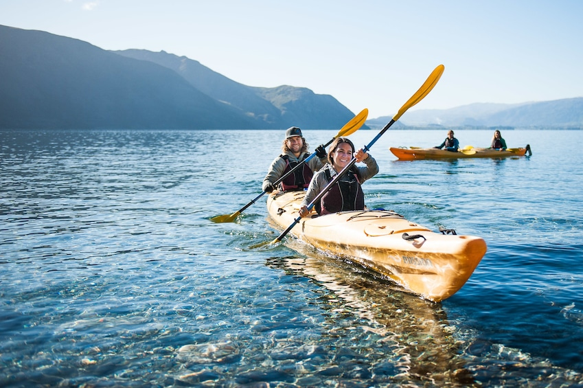 Show item 1 of 4. People out kayaking on Lake Wanaka in New Zealand