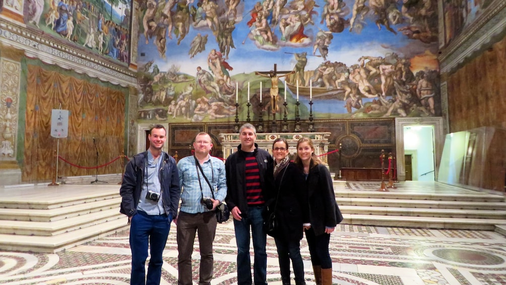 Show item 2 of 9. Tour group poses for photo in the vatican in Rome