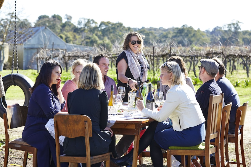 Show item 3 of 9. Group enjoying wine at winery in Adelaide