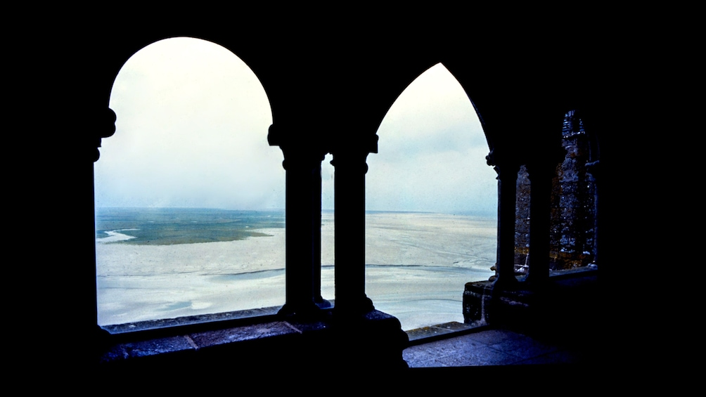 Show item 3 of 9. View through arched windows at Mont St Michel in France
