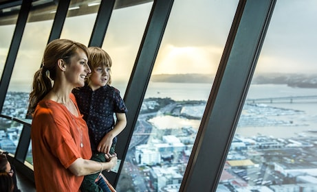 Mother and child look out on Auckland from the top of the Sky Tower