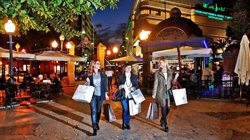 Shoppers in Alicante at night
