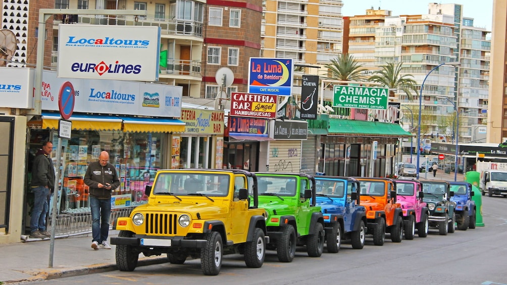 Show item 4 of 5. Colorful jeeps lined up in Costa Blanca