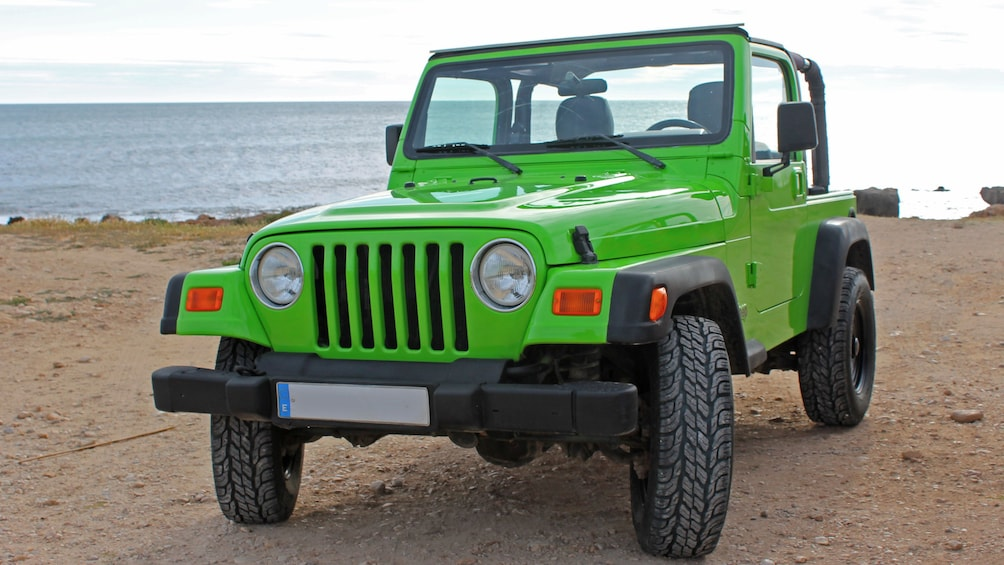 Show item 5 of 5. Jeep on a beach in Costa Blanca