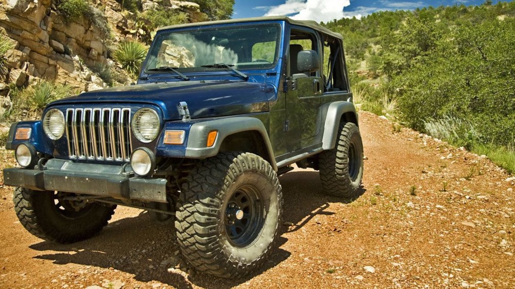Show item 1 of 5. Blue jeep on the road in Costa Blanca