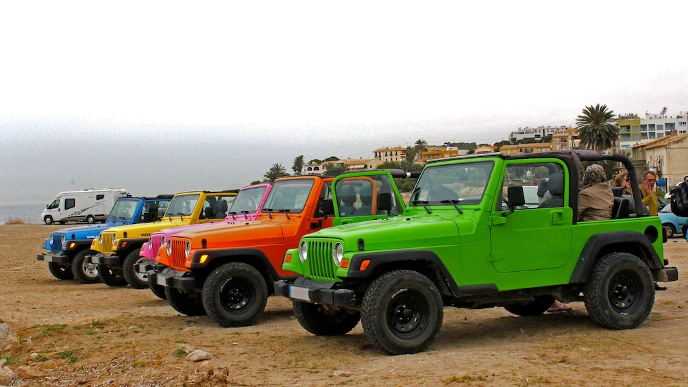 Show item 2 of 5. Colorful Jeeps parked on a beach in Costa Blanca