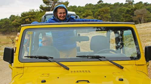 Person in a yellow jeep