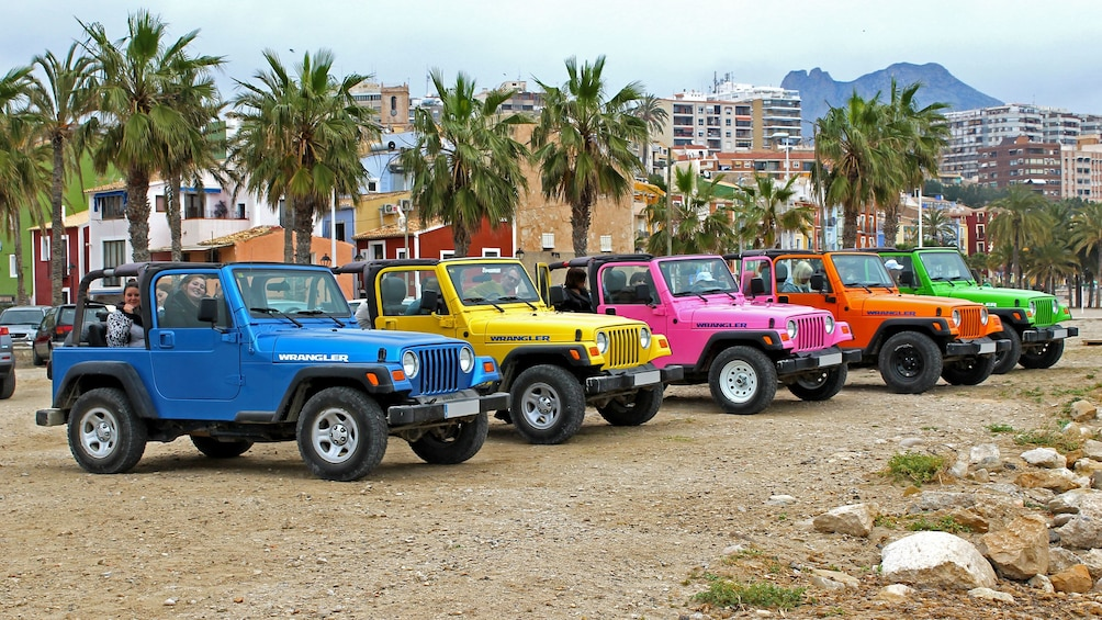 Show item 1 of 5. A Colorful assortment of jeeps parked in Costa Blanca