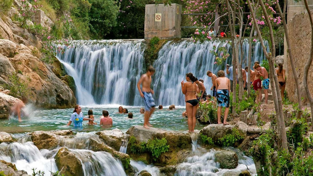 Show item 1 of 5. People at a natural pool in Costa Blanca