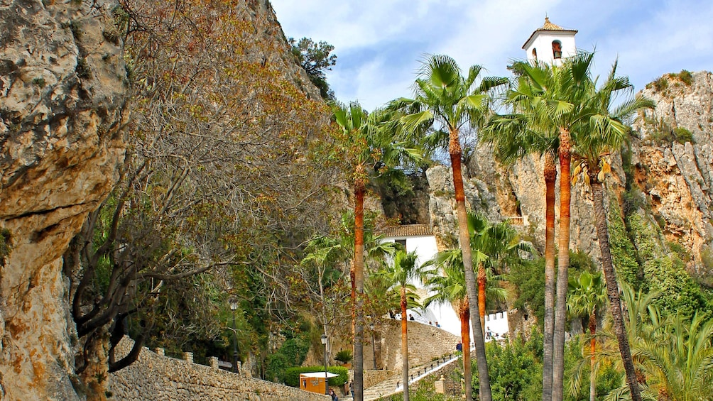 Show item 4 of 5. Looking up at buildings in Guadalest