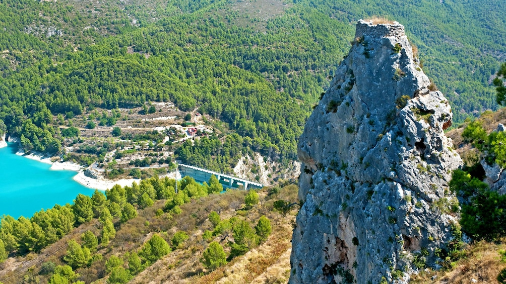 Show item 5 of 5. Rocky lookout overlooking the coast in Guadalest
