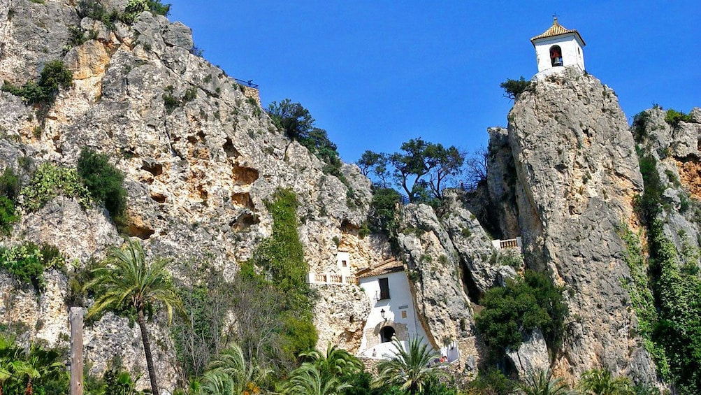 Show item 1 of 5. Bellower on top of cliffs in Guadalest