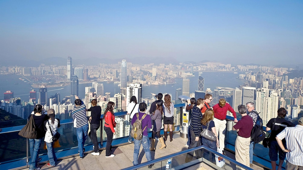 Show item 1 of 10. Visitors enjoying the cityscape view on the Hong Kong Island Tour