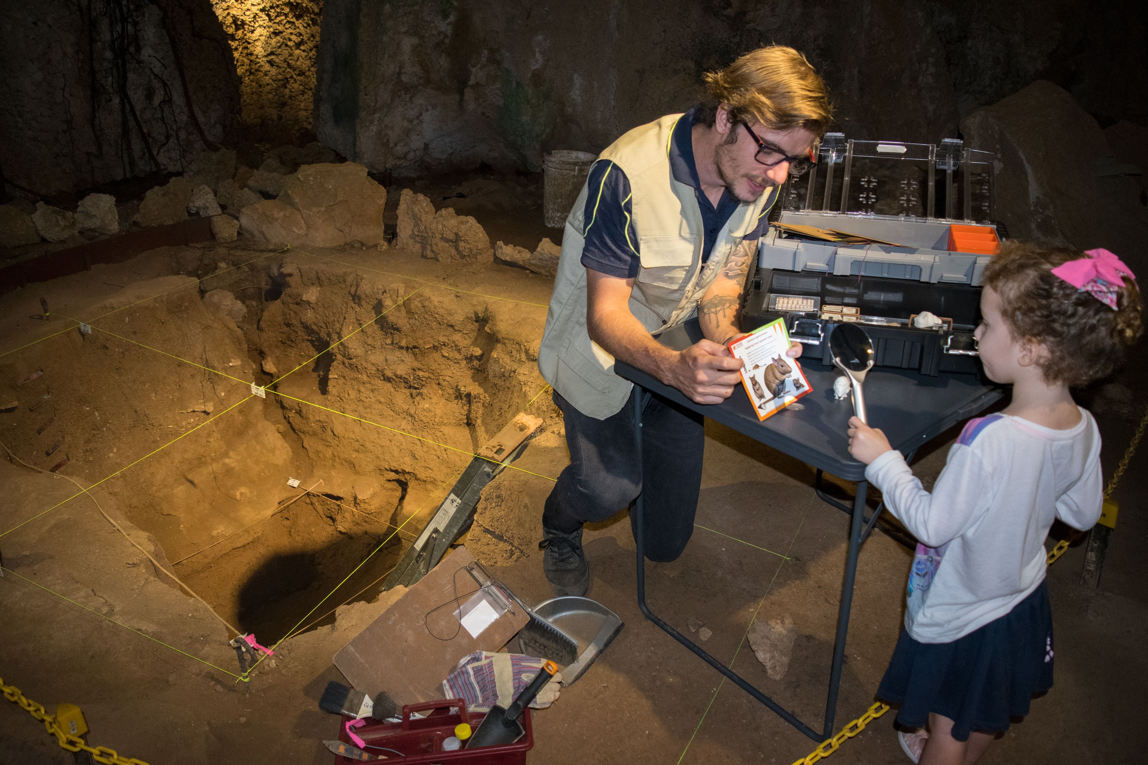 Man and child inside Capricorn Caves in Australia