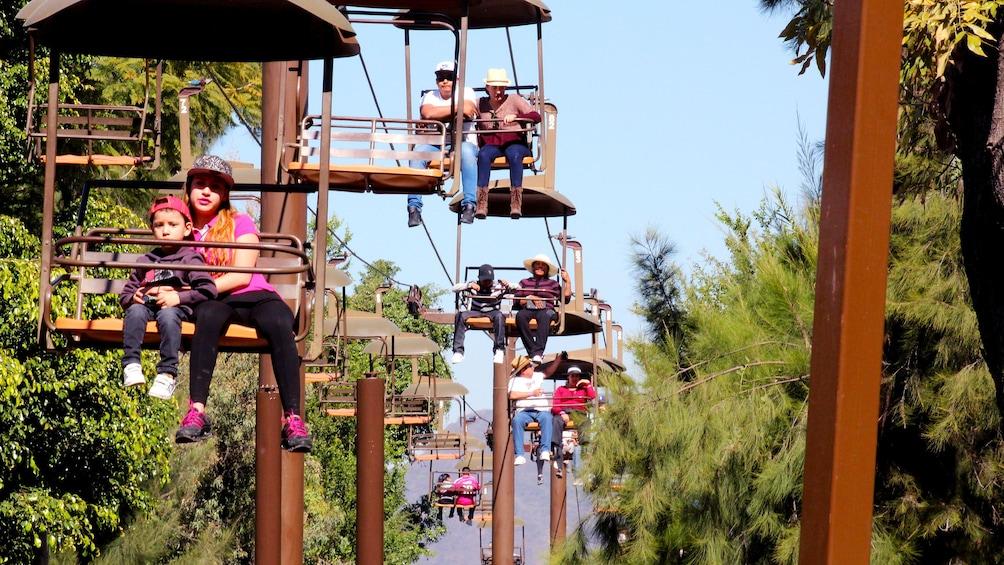 Cargar foto 8 de 8. People ride chair lift at zoo in Guadalajara