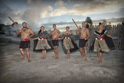 Six people dressed in traditional Maori clothing