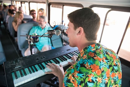 man playing music for bus of people in Texas