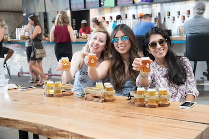 group toasting with beer at a brewery in Texas