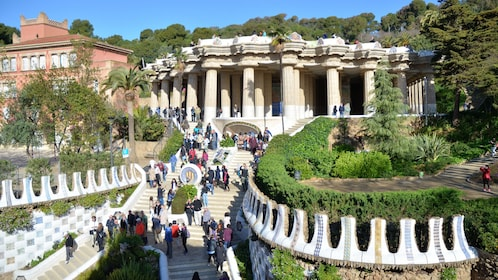 Tourists walking up steps to columned building in Barcelona