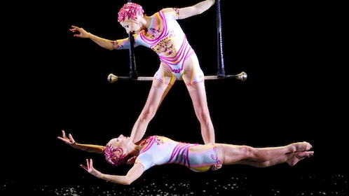 Trapeze artists hover over water in Cirque du Soleil O at the Bellagio in Las Vegas
