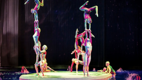 Performers climbing and balancing on one another in Cirque du Soleil O at the Bellagio in Las Vegas