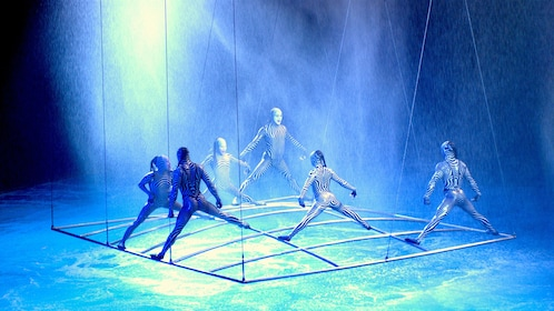 Performers balancing on grid system over water in Cirque du Soleil O at the Bellagio in Las Vegas