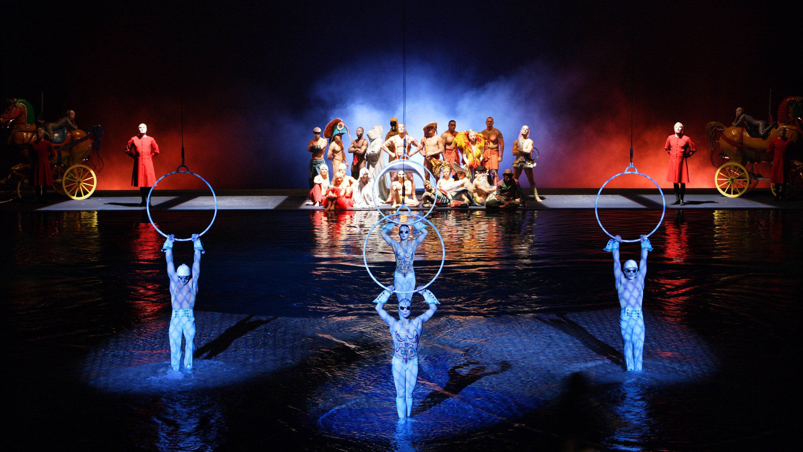 People hang from rings over pool in Cirque du Soleil O at the Bellagio in Las Vegas