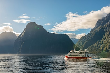 Landscape view of a boat touring the Milford Sound