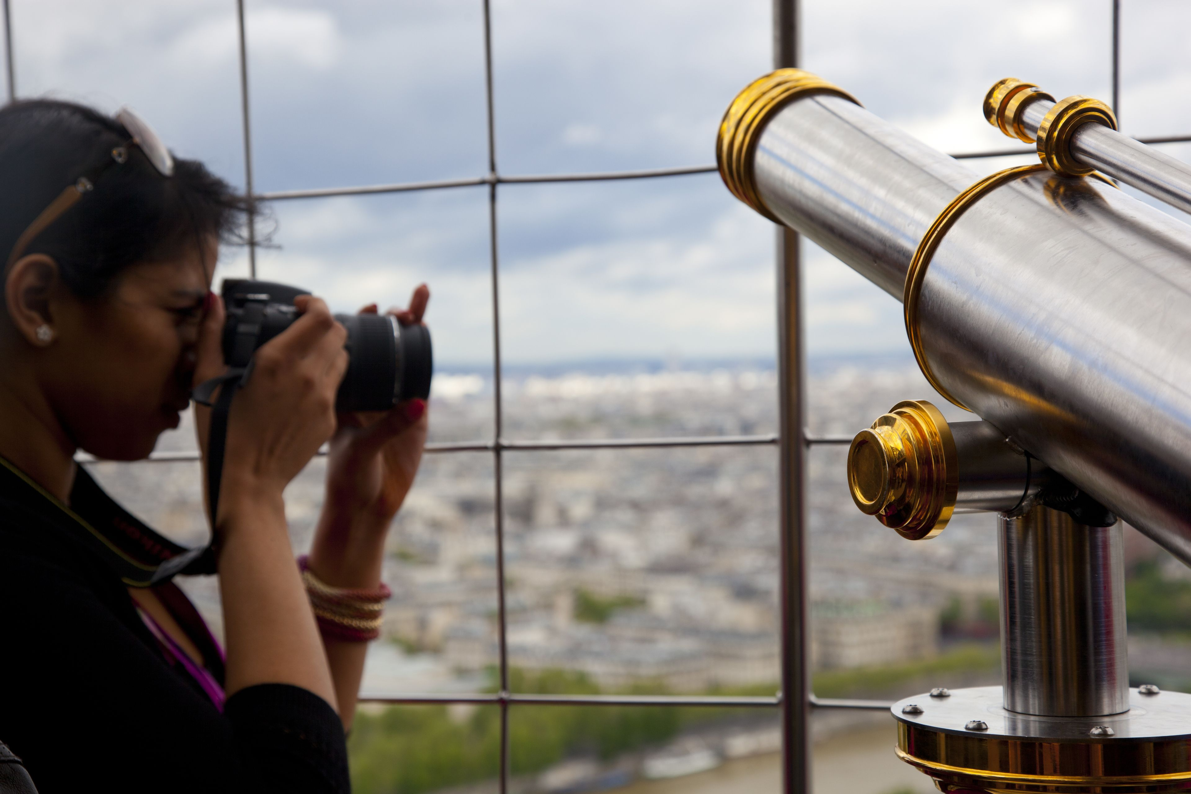 Woman taking a photo from the Eiffel Tower