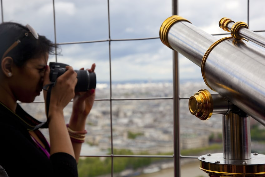 Show item 2 of 6. Woman taking a photo from the Eiffel Tower