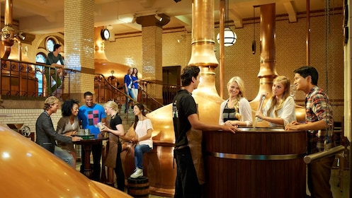 People in Heineken brewery in Amsterdam