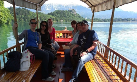 Tour group heading to Bled Island in small passenger boat