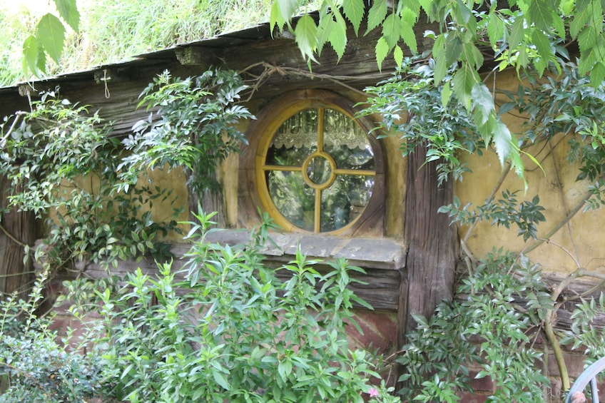 Show item 1 of 4. Window to home in Hobbiton in New Zealand