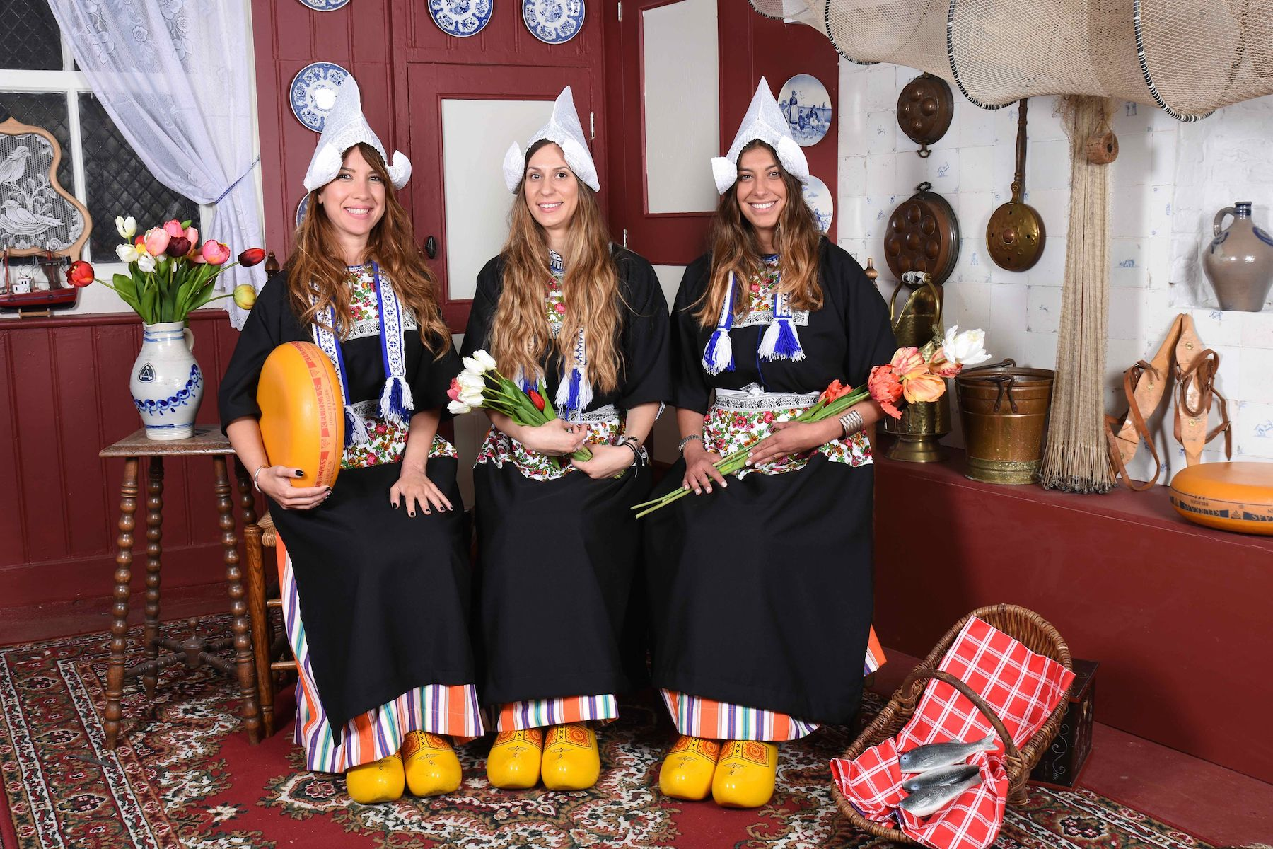Three women wearing traditional clothing at the Dutch Costume Museum