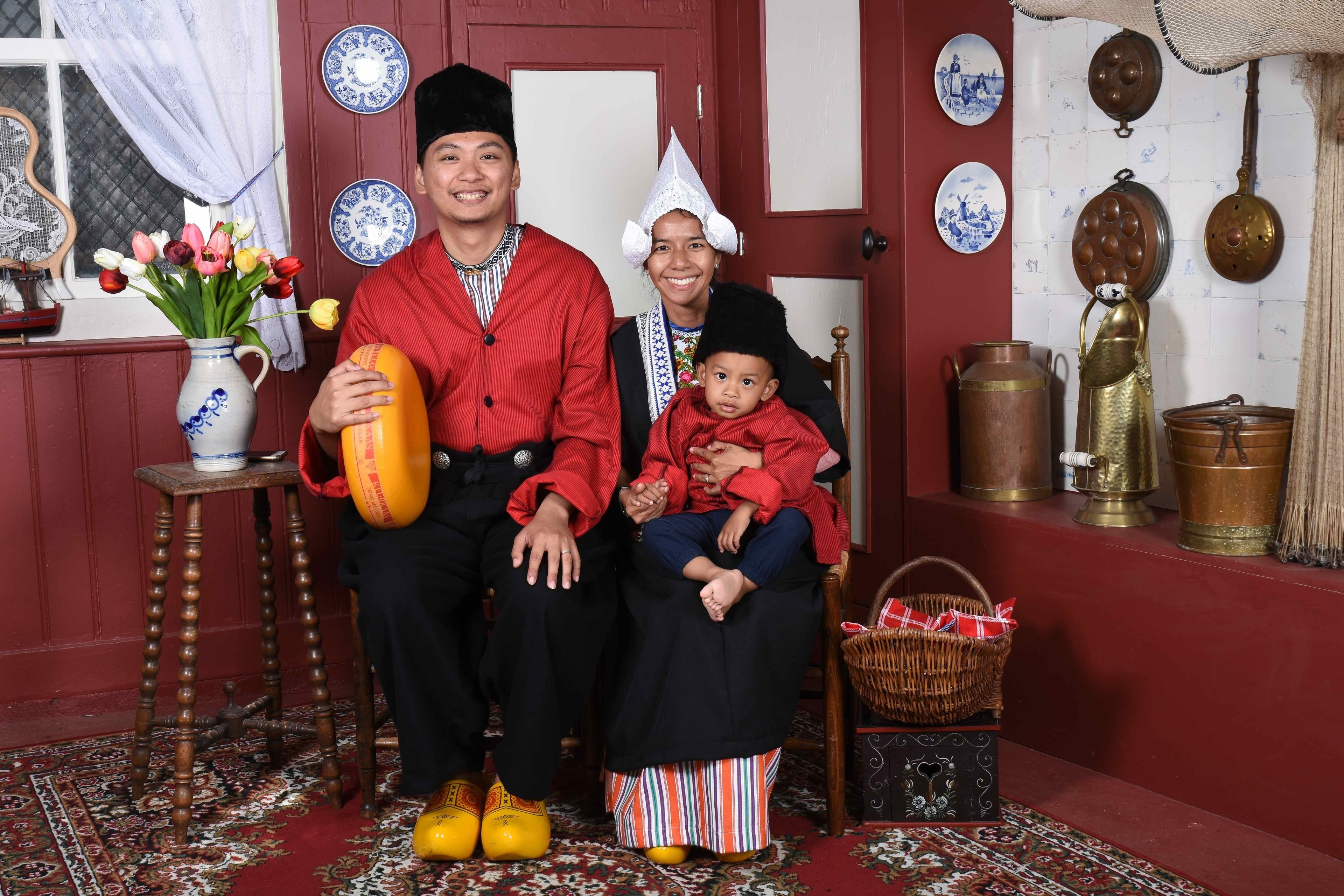 Asian family dressed in traditional clothing at the Dutch Costume Museum