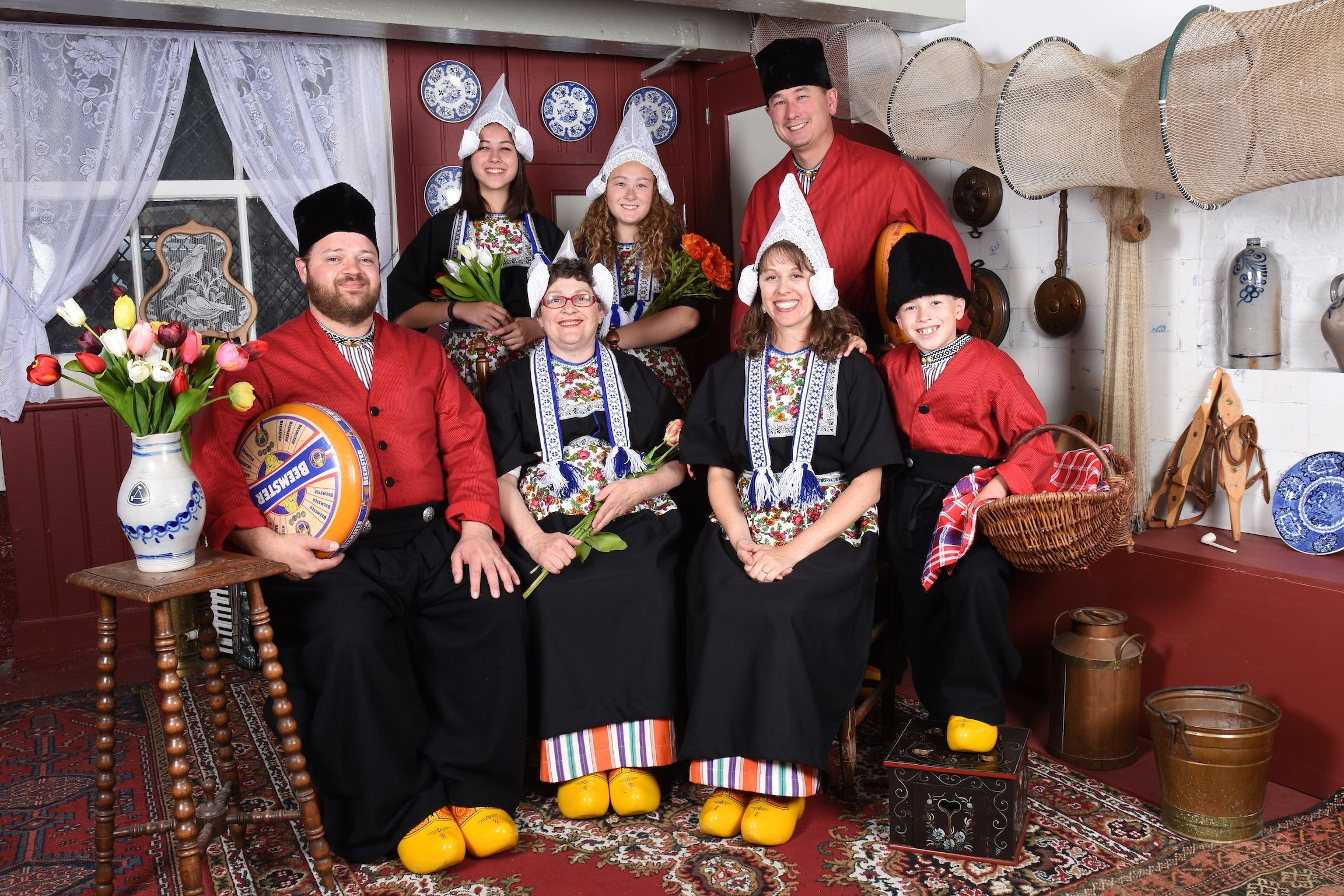 A group of tourists dressed in traditional clothing at the Dutch Costume Museum