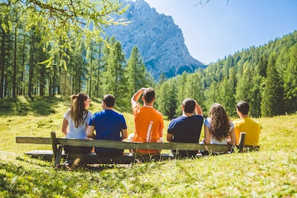 Group looks out to the Julian Alps on a sunny day in Slovenia