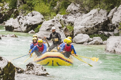 Group whitewater rafting on the Soca river in Slovenia