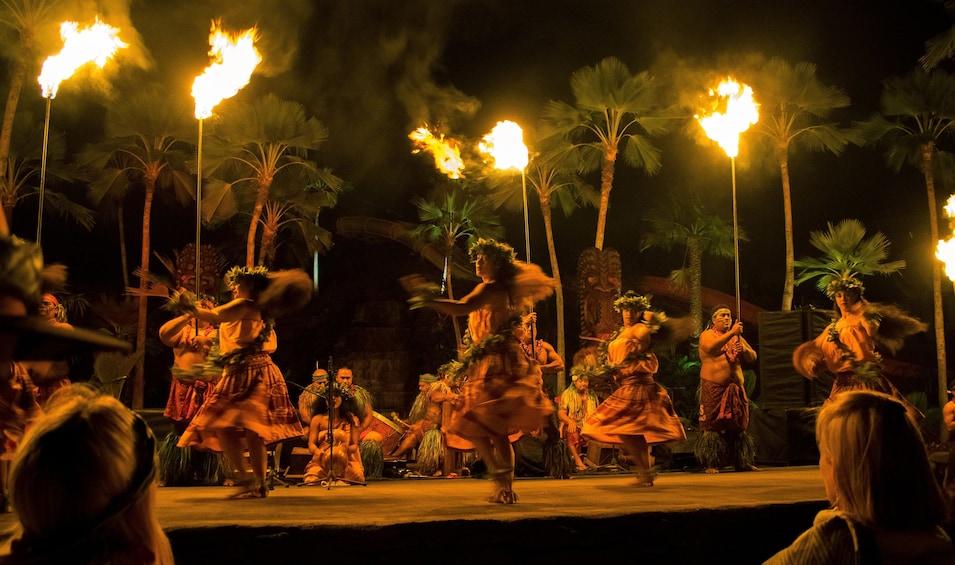 Hula dancers onstage at a luau on Oahu