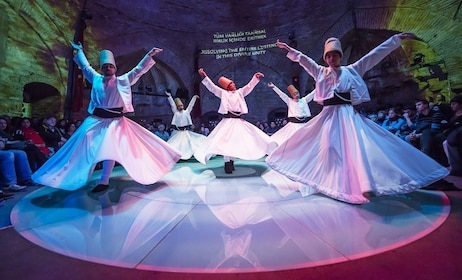 Performers dancing during Whirling Dervishes Live Show in Istanbul