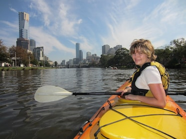 Woman smiling for picture with city in background in Melbourne
