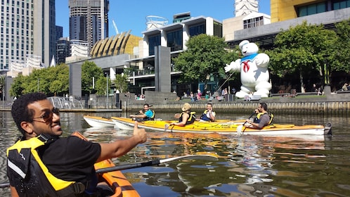 Group kayaking down canal in Melbourne