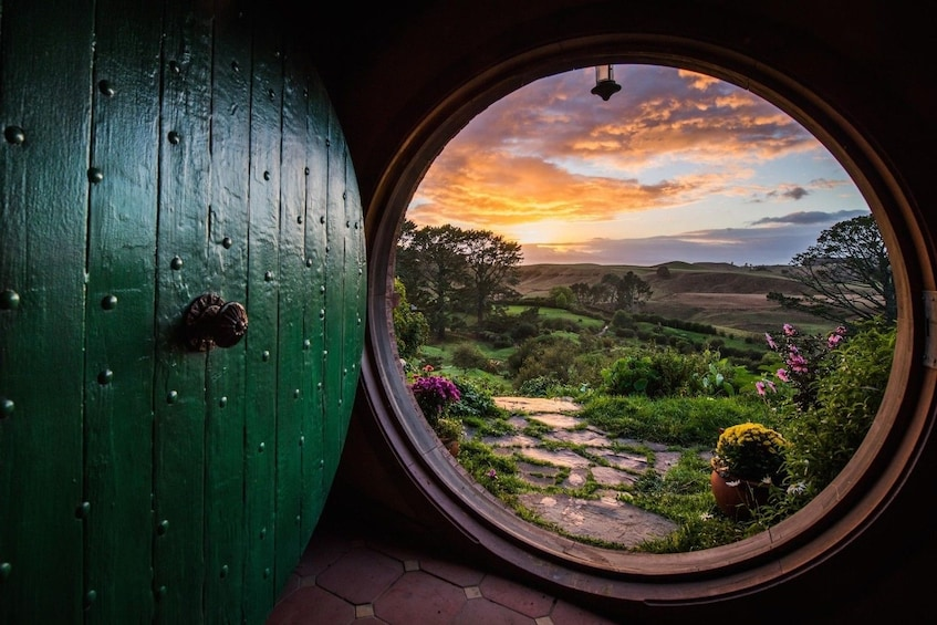 Show item 2 of 7. Looking out from round door onto the Shire in Hobbiton