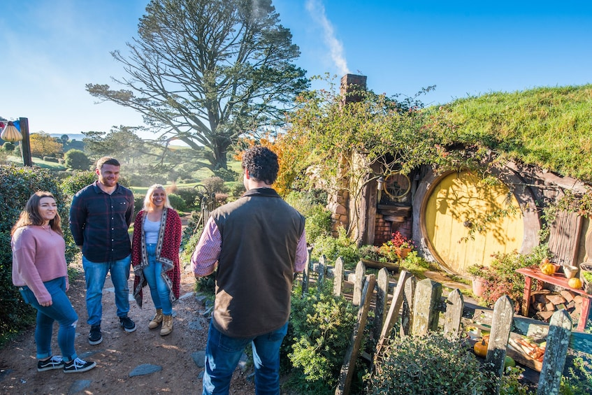 Show item 1 of 7. Tour guide leads group on The Shire in Hobbiton