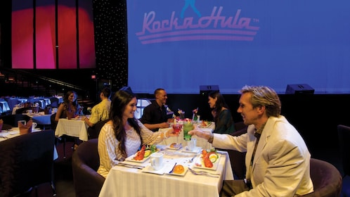 People sit down at Rock-a-Hula Stageside VIP Dinner & Show