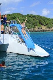 woman sliding down waterslide on the catamaran