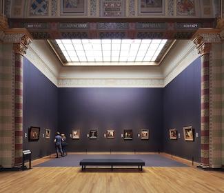 People viewing artwork in gallery at Rijksmuseum in Amsterdam